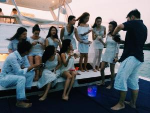 Popping Champagne at our Yacht Party!